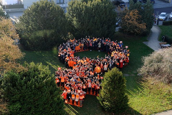 Flashmob to show solidarity to « No to violence against women » (23.11.2018). The goal was to reunite as many people as possible all in « orange » and to form the symbol of the end of violence against woman